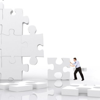 business man making a puzzle isolated